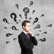 Man with questions mark — Stock Photo #18676817