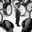 Man and clocks - Stock Photo