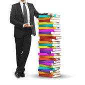Businessman and books — Stock Photo
