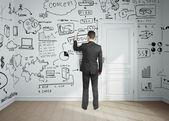 Mann zeichnung business-plan — Stockfoto