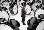 Człowiek i zegary — Zdjęcie stockowe