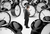 Man and clocks — Stock fotografie