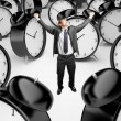 Royalty-Free Stock Photo: Man and clocks