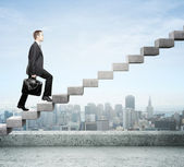 Stepping up a staircase — Stock Photo
