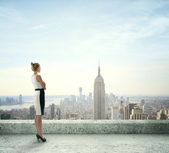 Woman on roof — Stock Photo