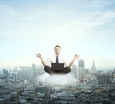 Businessman meditating — Stock Photo