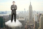 Man on cloud — Stock Photo