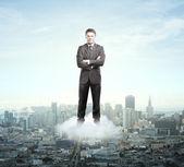 Businessman on cloud — Stock Photo