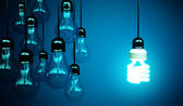 Lightbulbs on blue — Stok fotoğraf