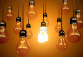 Lightbulbs on yellow — Stock Photo