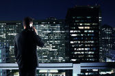 Man looking to night city — Stock Photo