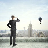 Businessman looking at city — Stock Photo