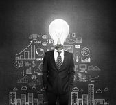 Businessman with lamp — Stock Photo