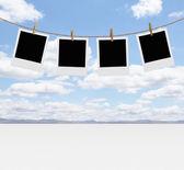 Photos hanging — Stock Photo