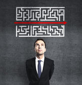 Businessman looking at maze — Stock Photo