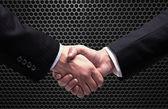 Handshake on metal — Stock Photo