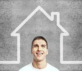 Man och hus — Stockfoto