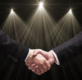Handshake and lamps — Stock Photo