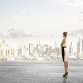 Woman looking on city — Stock Photo
