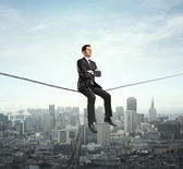 Man sitting on rope — Stock Photo