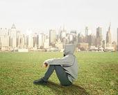 Man sitting on grass — Stock Photo
