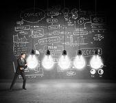 Businessman pushing bulbs — Stock Photo