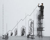 Businessman and drawing graph — Stock Photo