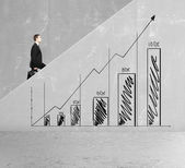 Businessman rises — Stock Photo