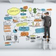Businessman drawing graph — Stock Photo #24982577