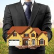 Man holding house — Stock Photo