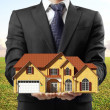 Man holding house - Stock Photo
