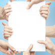Many hands holding poster — Stock Photo #25033197