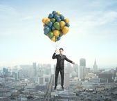 Businessman flying — Stock Photo