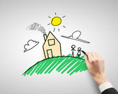 Drawing house and family — Stock Photo