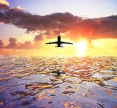 Airplane and sea — Stock Photo