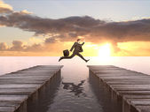 Man with briefcase jumping — Photo