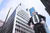 Businessman and skyscraper — Stock Photo