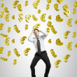 Falling gold dollar and euro — Stock Photo