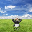 Businnessman sitting on nature — Stock Photo #27134147
