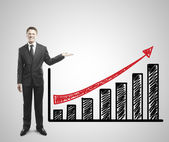 Man shows graph — Stock Photo