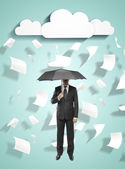Businessman and flying paper — Stock Photo