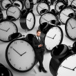 Businessman and many clock — Stock Photo