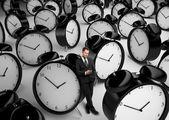 Businessman and many clock — Stock Photo