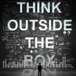 Man looking at think outside the box — Stock Photo #29316599