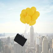 Briefcase flying — Stock Photo