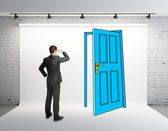 Businessman looking at drawing door — 图库照片