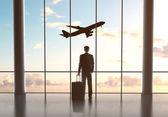 Homme d'affaires à la recherche en avion — Photo