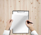Hands drawing in clipboard — Stock Photo