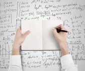 Hands drawing in blank book — Stock fotografie