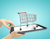 Touch pad with cart — Stock Photo